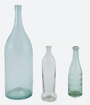 Trzy butelki szklane