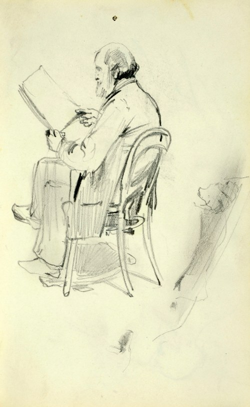 Stanisław Kaczor Batowski (1866-1945), Stary mężczyzna z brodą siedzący na krześle patrzący na trzymany przed sobą plik arkuszy papieru.