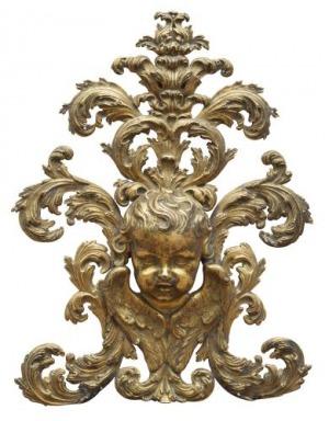 Aplika - putto (An Italian gilt bronze putto applied ornament)