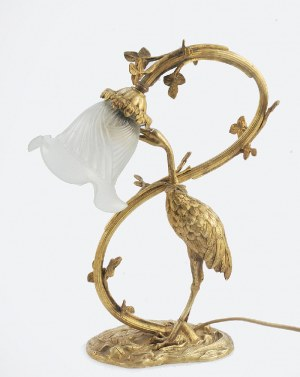 Lampa elektryczna z figurką żurawia