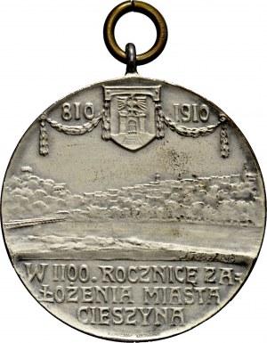 Medalik z 1910 roku medal sygnowany J. RASZKA i L.CHR.LAUER NUERNBERG, wybity dla uczczenia 1100-lecia powstania miasta Cieszyna.