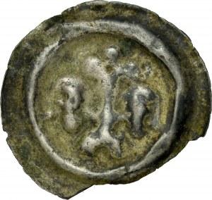 Łużyce, Brakteat XIII w, Av.: Lilia na postumencie, po bokach głowy.